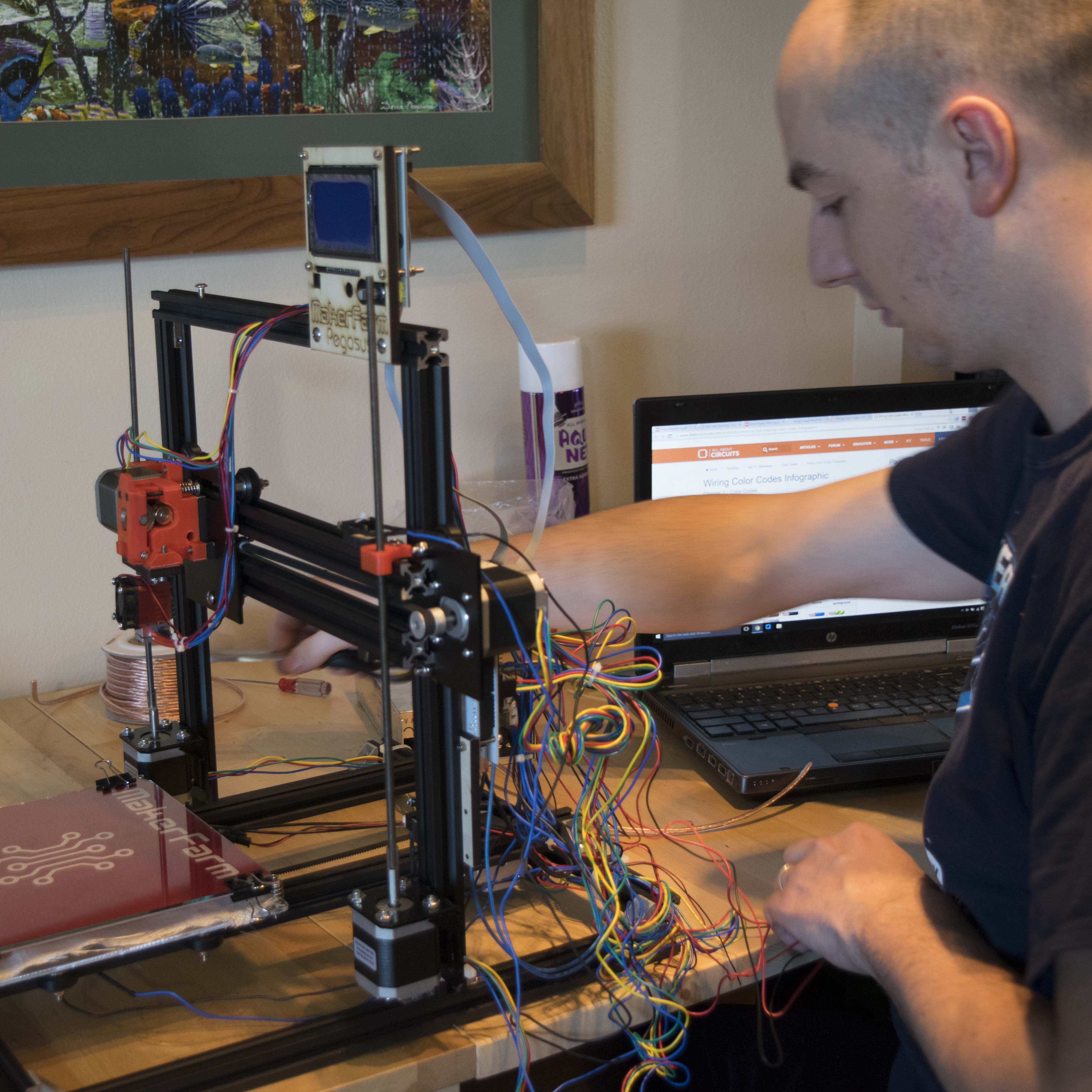 Brian Weis using 3D Printer